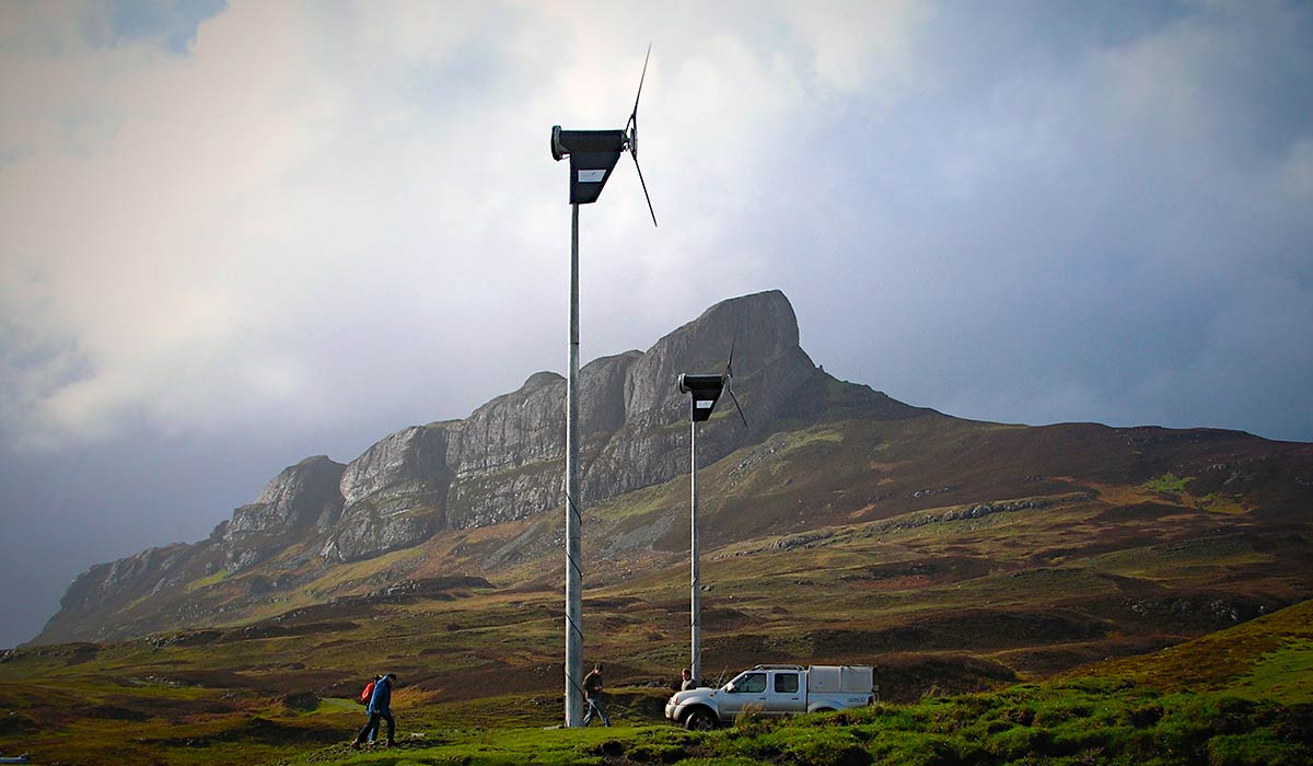 Two of Eigg's wind turbines, and An Sgurr in the background.